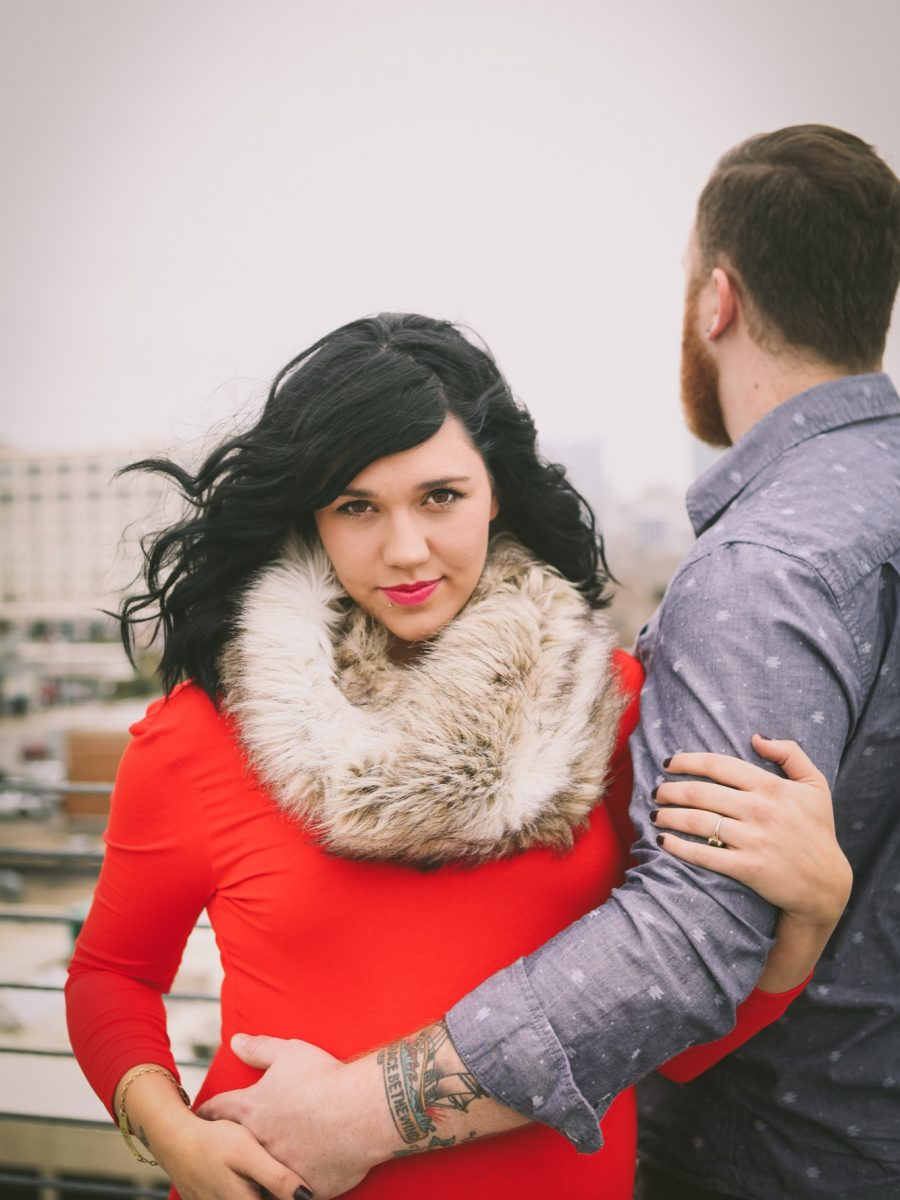 Jaymes and Jordan Downer maternity photoshoot in downtown fort worth red dress with fur scarf